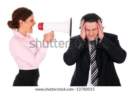 Businesswoman with megaphone yelling at businessman