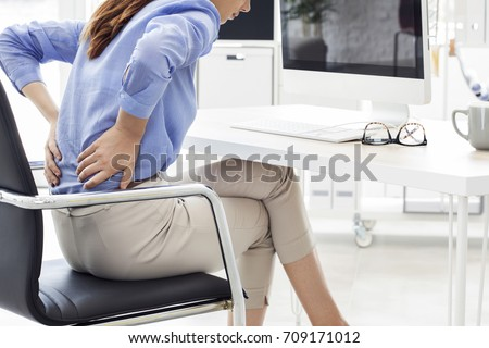 Businesswoman with pain in back  #709171012