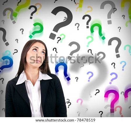 businesswoman with question marks behind her, hard decision