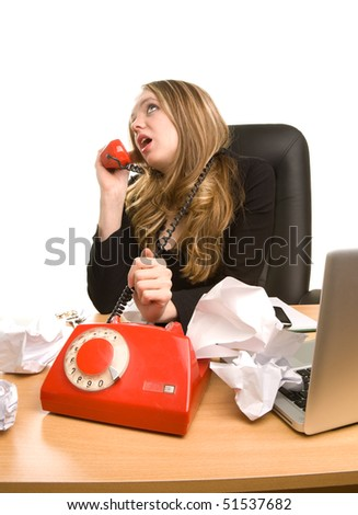 Businesswoman with sheet of paper and telephone on the table