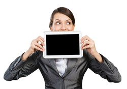 Businesswoman with tablet computer looking away. Portrait of attractive woman in formalwear showing tablet PC near her face. Corporate businessperson and digital technology layout with copy space