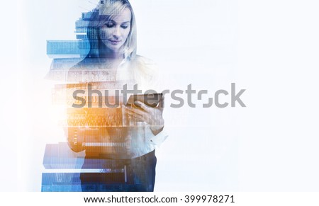Businesswoman with tablet, office building. Double exposure. Concept of taking photos.