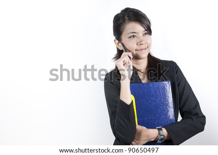 Businesswoman wlth pen in hand, isolated on white - stock photo