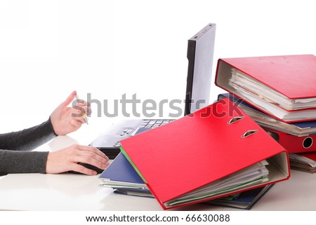 businesswoman - woman hand on mouse pen and computer. Pile of folders with old documents and bills. Isolated on white background