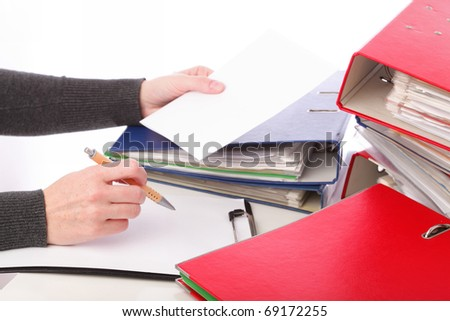 businesswoman - woman hand pen. Pile of folders with old documents and bills. Isolated on white background - stock photo