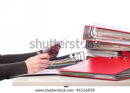 businesswoman - woman hand pen. Pile of folders with old documents and bills. Isolated on white background