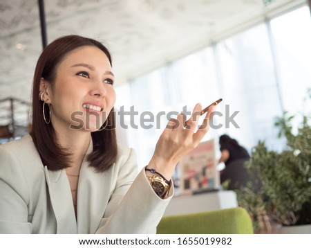 businesswoman work boss manager executive professional portrait is smiling and sit cheerful on hand sign communication customer