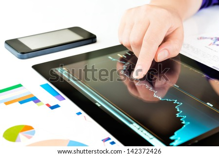 Businesswoman work with documents and tablet computer