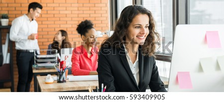 Businesswoman working in creative office with multiethnic colleagues, panoramic banner