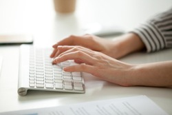 Businesswoman working on computer concept, female hands typing text on keyboard, woman using desktop for writing business emails, communicating in corporate messenger, doing job online, close up view