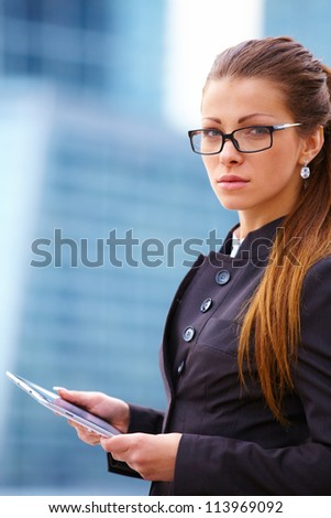 Young business woman with digital tablet