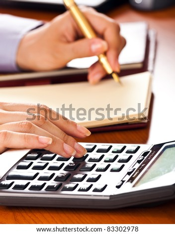Businesswoman working on her desk in the office