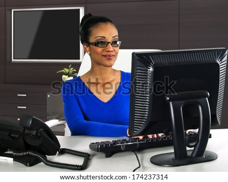 businesswoman working with a computer in the office