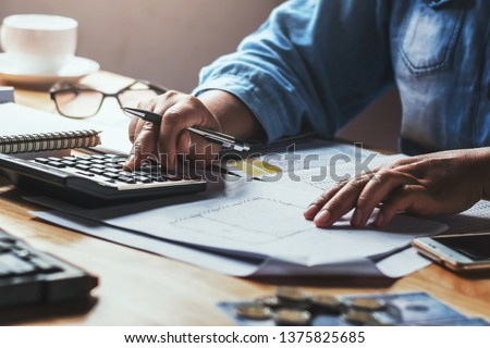 businesswoman working with using calculator in office #1375825685