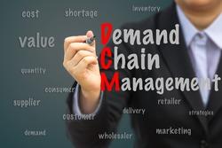 Businesswoman write Demand Chain Management (DCM) relation concept.