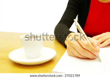 businesswoman writes a pen on an empty paper
