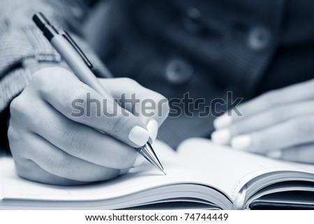Businesswoman writing