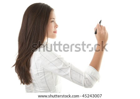 Businesswoman writing or drawing with pen on copy space / whiteboard. Casual beautiful young mixed race chinese / caucasian business woman isolated on seamless white background. Bright with backlight