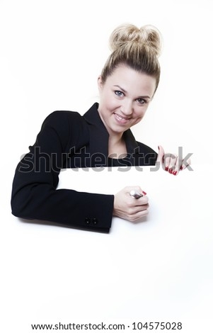 businesswoman writing with a maker pen on white card in front of her