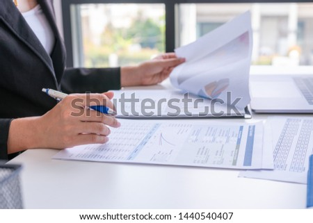 Businesswomen analysis comparing financial reports. Financial reports are set of documents prepared by an administrative team and ceo recheck report profit. Concept business finance