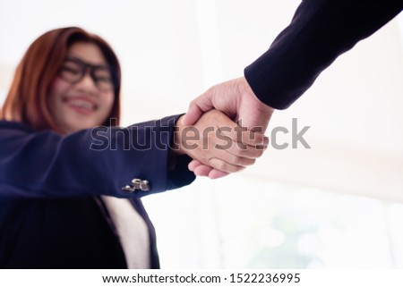 Businesswomen and businessmen handshake to express greetings, happiness and success in agreements #1522236995