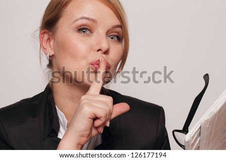 Businesswomen making hush gesture
