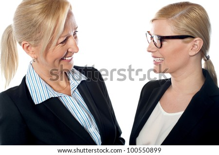 Businesswomen meeting and discussing company's progress