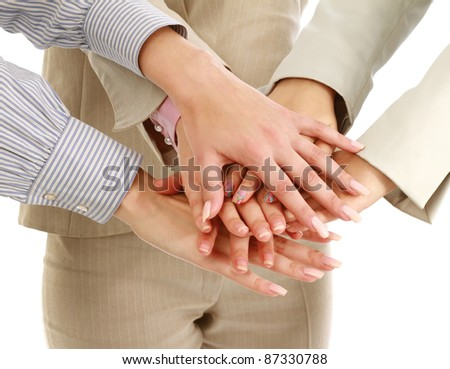 Businesswomen putting their hands together, isolated on white, closeup