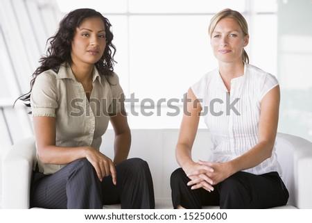 Businesswomen sitting in office lobby