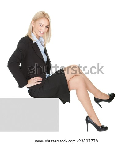 Businesswomen sitting on copyspace. Isolated on white