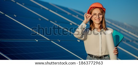 Businesswomen working on checking equipment at solar power plant with tablet checklist, woman working on outdoor at solar power plant.