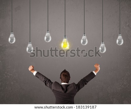 Businness guy in front of bright idea light bulbs concept