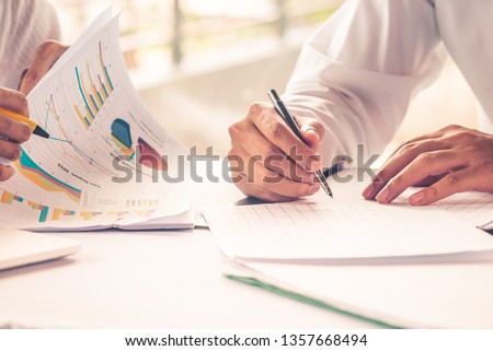 Bussiness concept, Business people working together. Bussiness Team, Bussiness man working discussing the charts and graphs showing the results