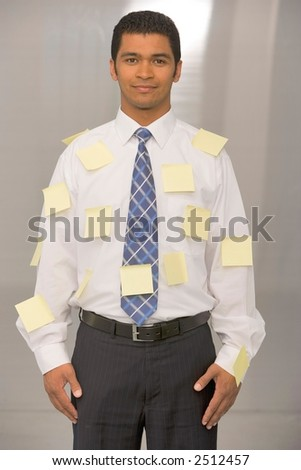 Bussiness Man in Suite covered in Stickies
