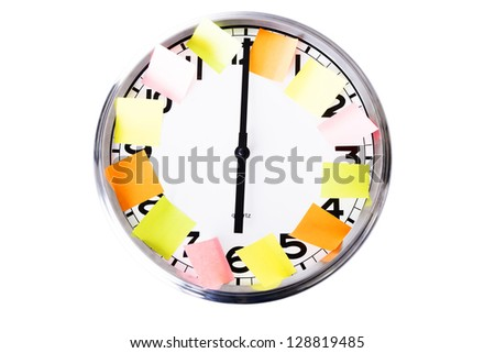Bussy business day planning concept. Sticky notes on office clock. Isolated on white