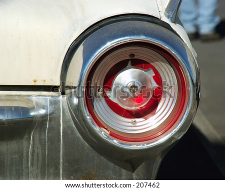 Busted tail light on abandoned car