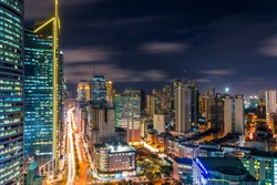 Bustling scene of Ayala Avenue and Makati Skyline at night, during rush hour. Cityscape of Makati, a major CBD in Metro Manila, Philippines.
