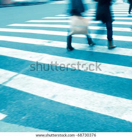 Busy big city street people on zebra crossing