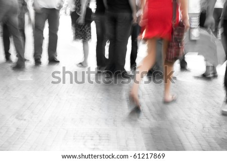 Busy big city street. Woman in red among black and white - stock photo