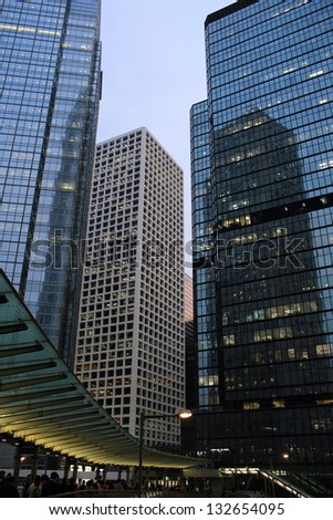 busy business financial offices in the city of life in low angle view in hong kong - stock photo