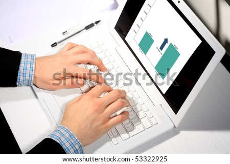 Busy business man doing some computer work
