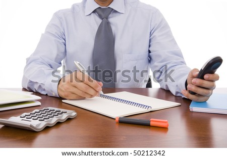 Busy business man writing something in his notebook