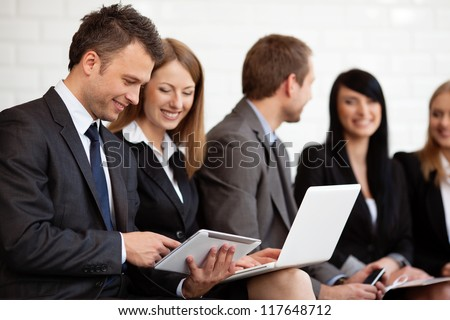 busy business people working digital tablet and laptop. Selective focus stock photo