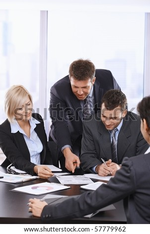 Busy business people working together, talking on office meeting.?