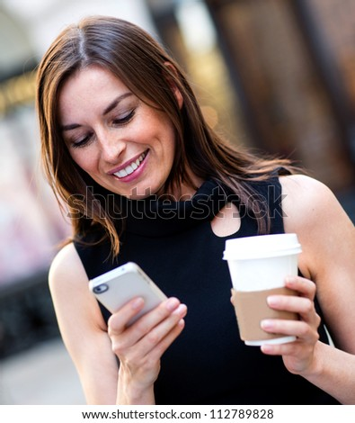 Busy business woman texting on her cell phone