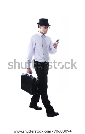 Busy businessman walking and using mobile phone isolated on white