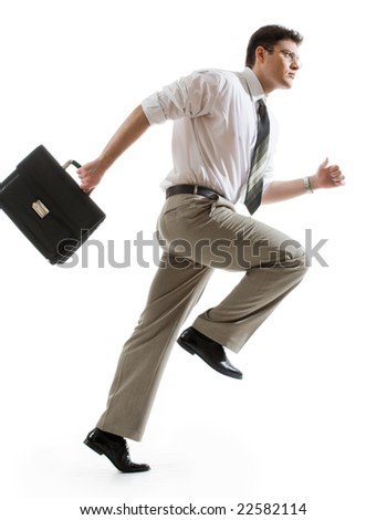 Busy businessman with briefcase running to important meeting