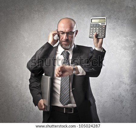 Busy businessman with four arms