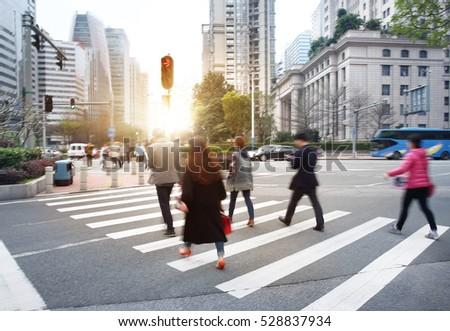 Busy city people crowd on zebra crossing street