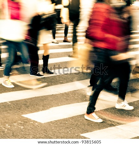 busy city people crowd on zebra crossing street